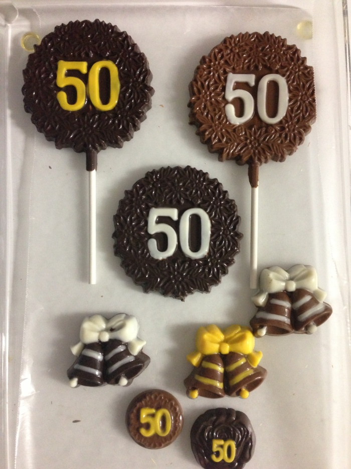 You can order customized chocolate favors for every occasion at Lori's Candy Station. Lori made these favors for a recent 50th birthday party.